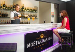 Ash prepares champagne cocktails at Lush Bar.